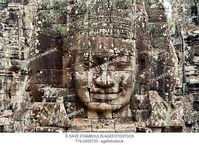 Giant stone face at the Bayon temple at Angkor Wat in Siem Reap, Cambodia