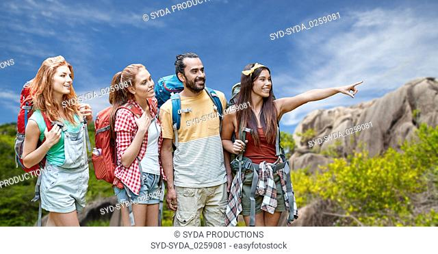 friends with backpacks over seychelles island