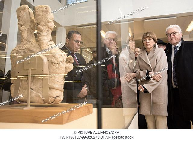 German President Frank-Walter Steinmeier and hsi wife Elke Buedenbender standing beside a 2-headed bust which is said to date back to 6,500 B.C