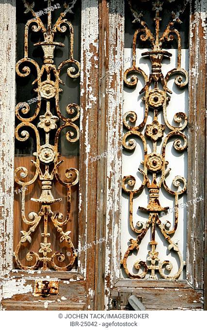FRA, France, Normandy, Grandville:rusty window grills of a door in the oldtown