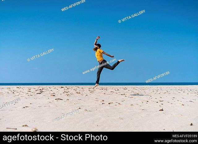 Carefree man running on beach