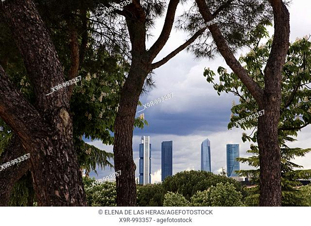 Four towers business area CTBA seen through the trees. Madrid. Spain
