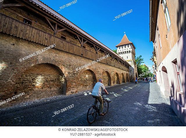 Potter's Tower (Turnul Olarilor) and old walls on a Strada Cetatii (Castle or Fortress Street) in Sibiu city of Transylvania region, Romania