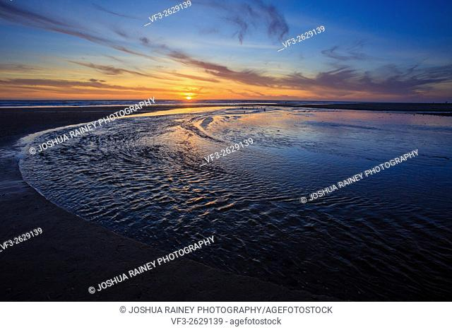 Amazing sunset on the D River Beach in Lincoln City Oregon, home of the world's shortest river that flows into the ocean