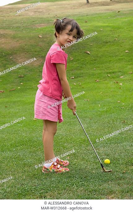 little girl playing golf