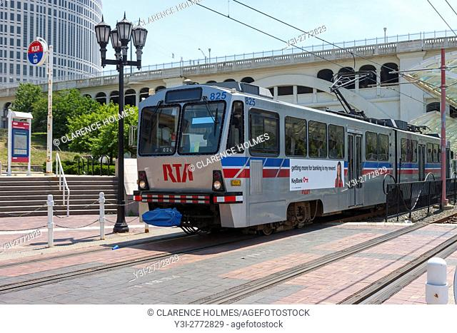 A Regional Transit Authority (RTA) train passes through Settlers Landing Station in the Flats area of Cleveland, Ohio. The train consists of an articulated...