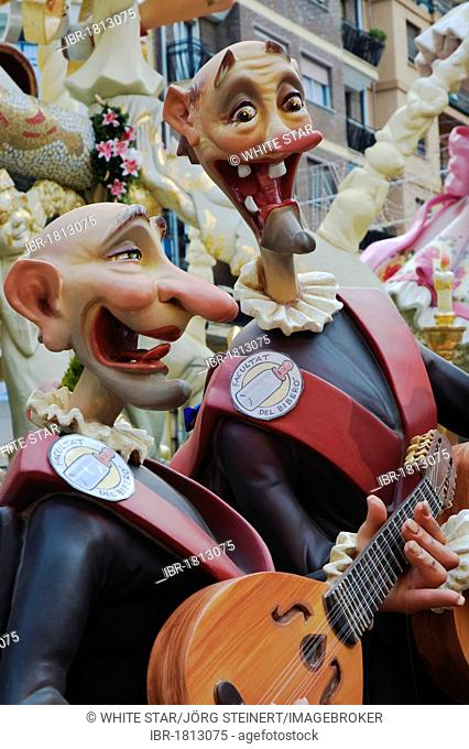 Gap-toothed musicians wearing uniforms, sculptures of the Faculty of Drinkers at a parade, Fallas festival, Falles festival in Valencia in early spring, Spain