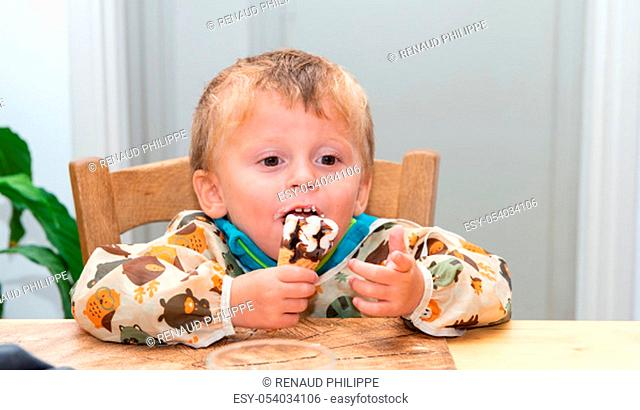 a two years old boy eating ice cream