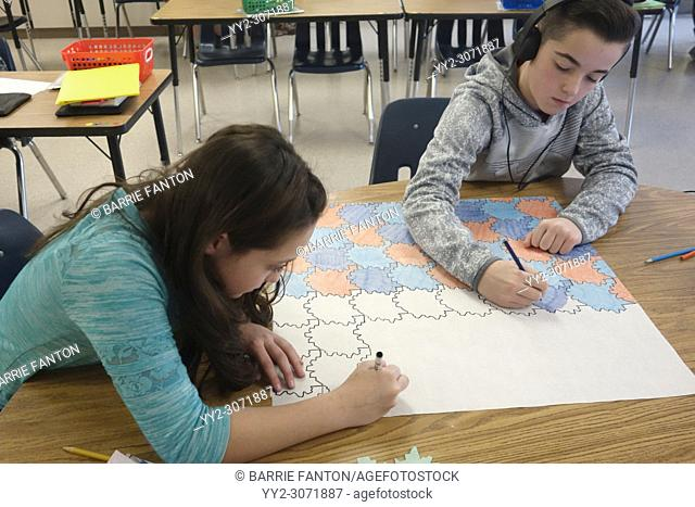 6th Grade Girl and Boy Working on Pattern Project in Math Class, Wellsville, New York, USA