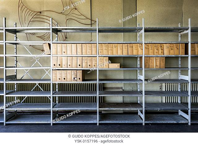 Rotterdam, Netherlands. Companies and enterprise accounts and archives, stored inside large, metal racks in an abandoned and former employees cantina building...