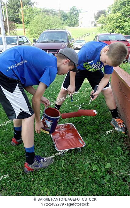 6th Grade Boys Pouring Paint for Community Service Day, Wellsville, New York, United States