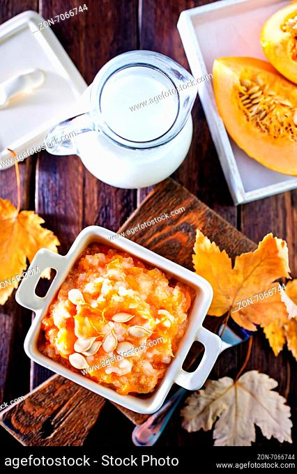 pumpkin porridge in bowl and on a table