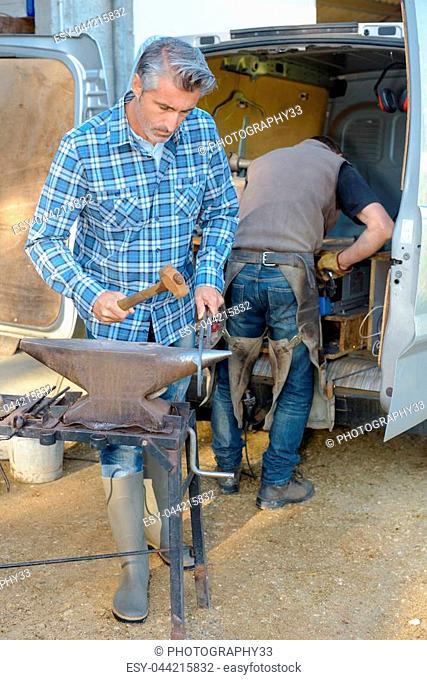blacksmith working outdoors