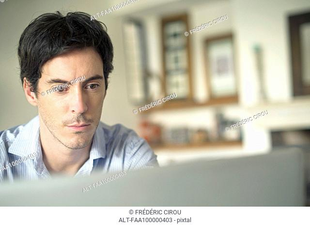 Man staring at laptop computer