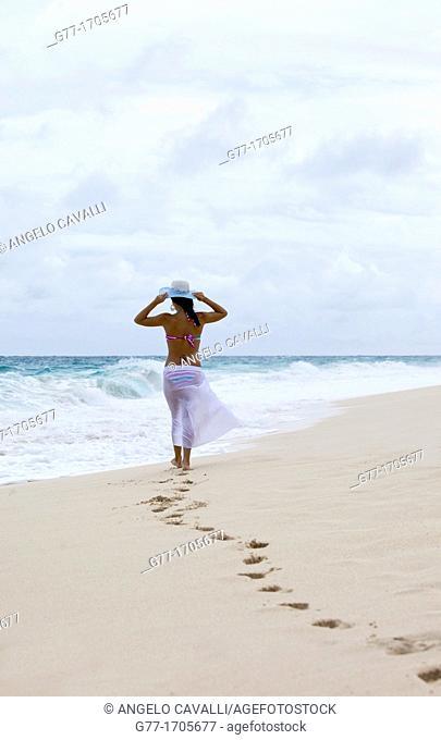 Caribbean  Barbados  Woman on a deserted beach