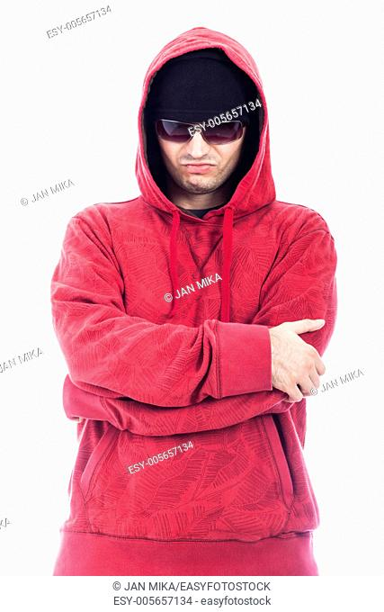 Self-confident hip-hop style man in red hoodie and sunglasses, isolated on white background