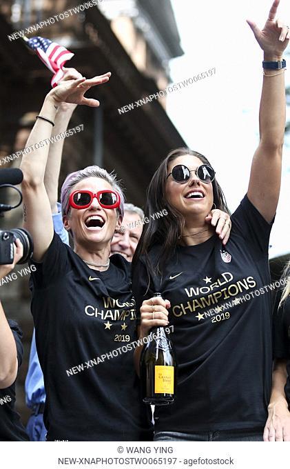 (190711) -- NEW YORK, July 11, 2019 (Xinhua) -- U.S. women's soccer team members Megan Rapinoe (L) and Alex Morgan celebrate during the ticker-tape parade for...