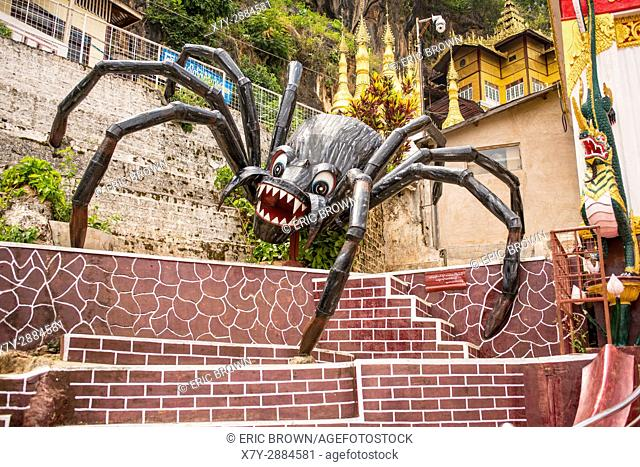 A giant spider in front of the Shwe U Min Pagoda, Myanmar