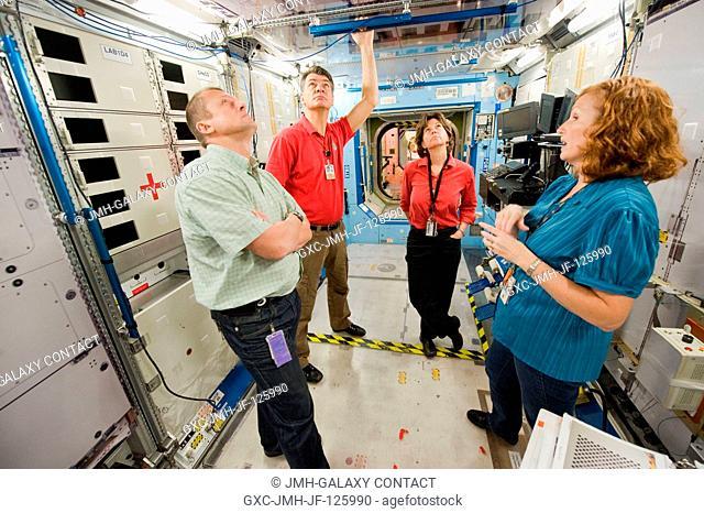Russian cosmonaut Dmitry Kondratyev (left foreground), Expedition 26 flight engineer and Expedition 27 commander; NASA astronaut Catherine Coleman (right...