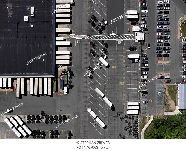 Aerial view sunny parking lot and commercial warehouse, New York City, New York, USA