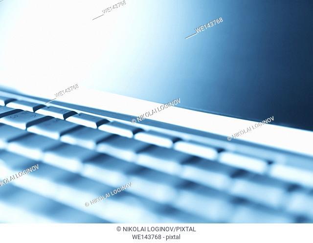 Diagonal perspective laptop keyboard bokeh background