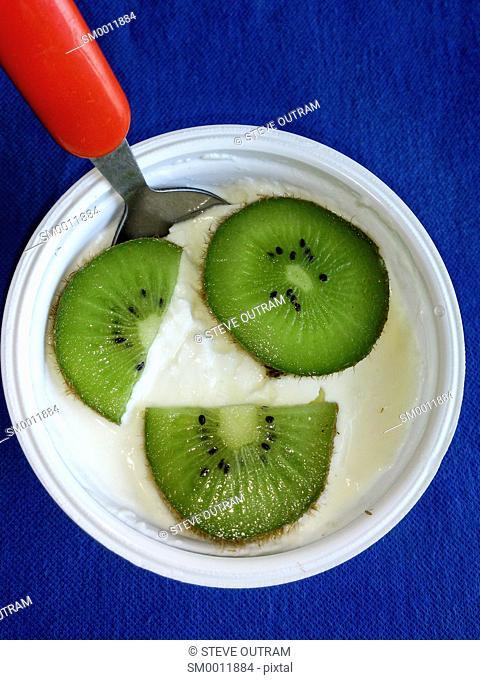 A Carton of Greek Yogurt with Passion Fruit