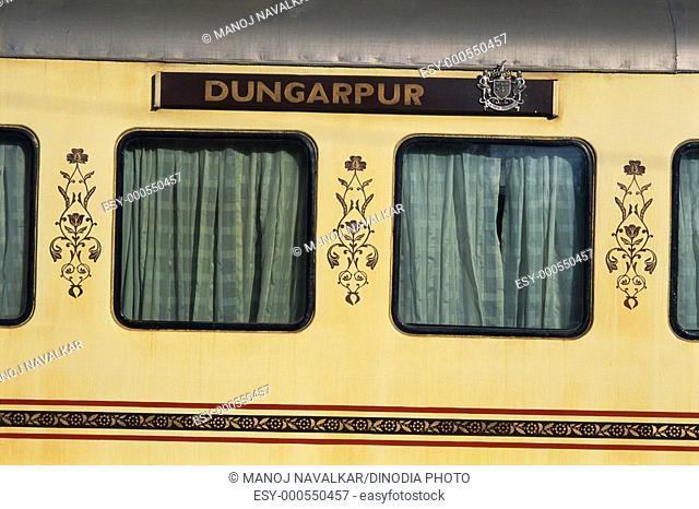 Close up of emblem of Dungarpur , compartment of palace on wheel train at Jaisalmer , Rajasthan , India