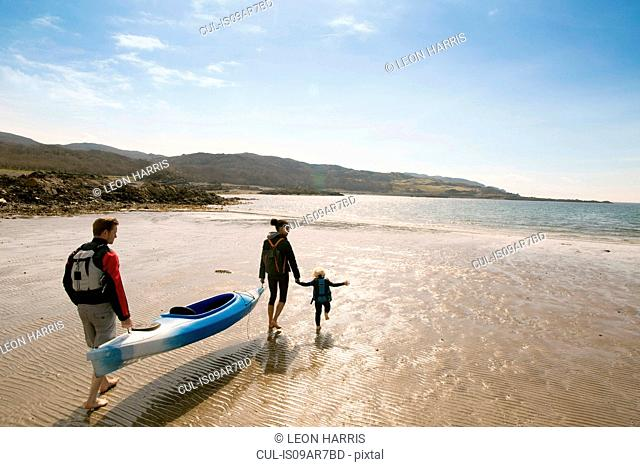 Family with canoe on beach, Loch Eishort, Isle of Skye, Hebrides, Scotland