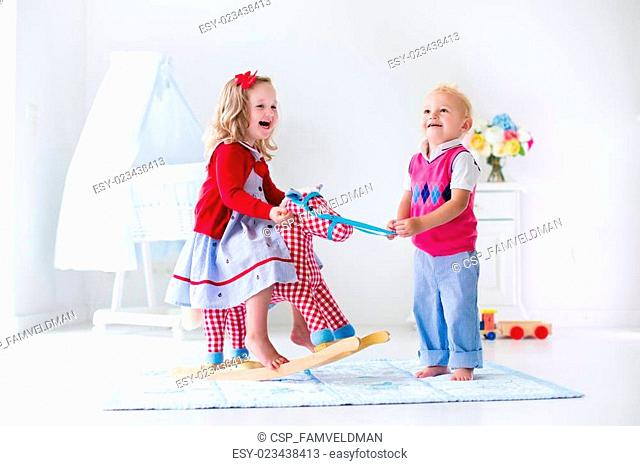 Kids playing with rocking horse