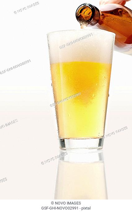 Man Pouring lager Beer into Glass, Close-Up