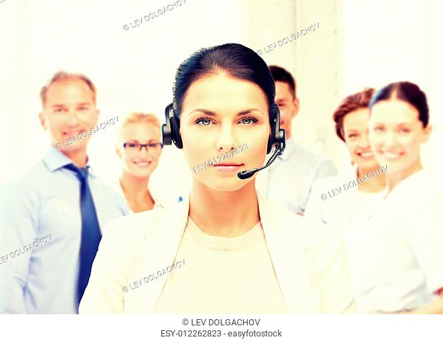 business and call center concept - helpline operator with headphones in call centre