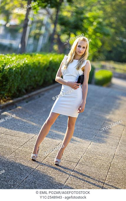 Young woman in stylish White dress