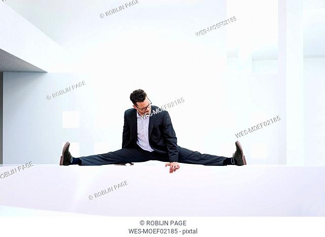 Businessman leaning on reception desk in office