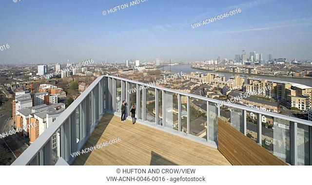 Greenwich Creekside, London, United Kingdom. Architect: Squire + Partners, 2012. Detail of communal roof top terrace with cityscape