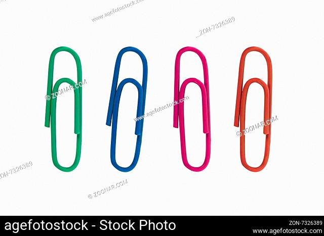 Close up detailed front view of four colorful paper clips, isolated on white background