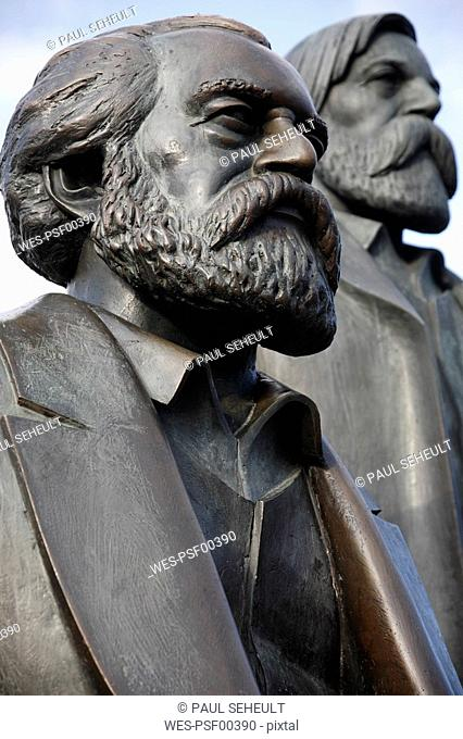 Germany, Berlin, Close-up of two statues, Marx and Engels, close-up