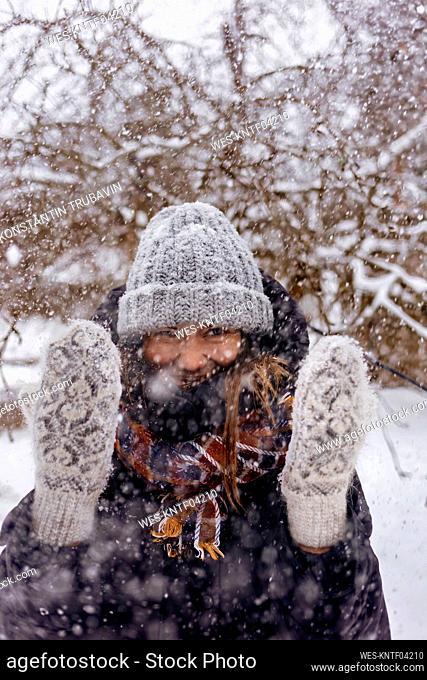 Portrait of woman enjoying snowfall