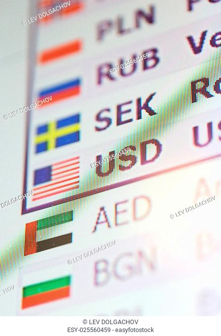finance, currency and money concept - digital display with exchange rates on screen