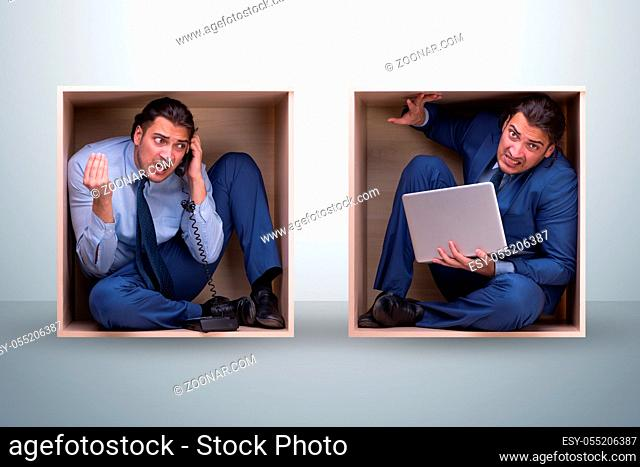 The employee working in tight space
