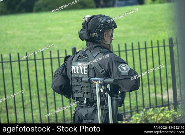 A United States Secret Service officer stands outside the White House Briefing Room after US President Donald J. Trump is removed by a US Secret Service agent...
