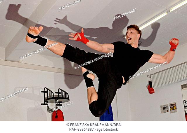 Police officer and kick boxing world champion Michael Smolik practices in Ellwangen,Germany, 30 April 2013. Photo. FRANZISKAKRAUFMANN   usage worldwide