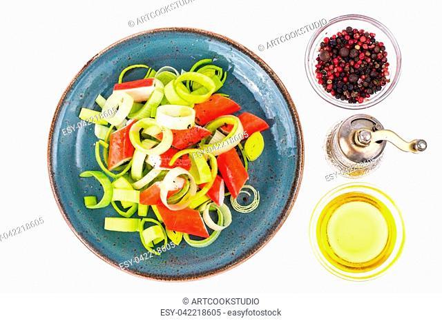 Salad with crab sticks on white background. Studio Photo