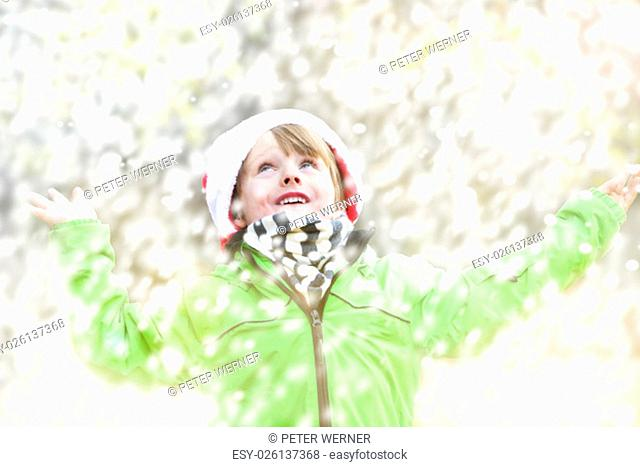 boy standing in the snow in winter