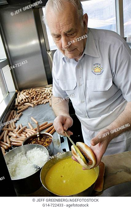 Virginia, Roanoke, Campbell Avenue, Roanoke Weiner Stand, man, cook, prepares, hot dog, mustard, onions, food