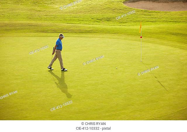 Man walking on golf course