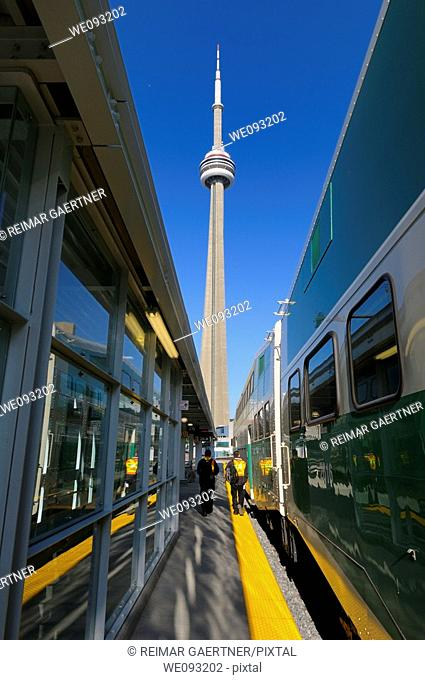 GO train at Union Station Toronto with CN Tower and work crew in the morning