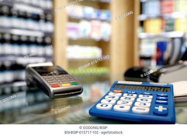 Pharmacy. Counter with drugs and calculator. France