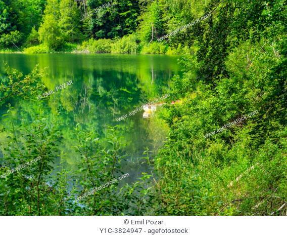 Spring season lonely boat Lokve lake near Mrzla vodica in Croatia