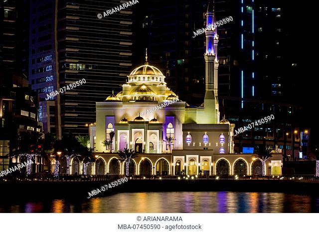 Beautiful illuminated mosque in Dubai marina at night, long exposure, Dubai, United Arab Emirates