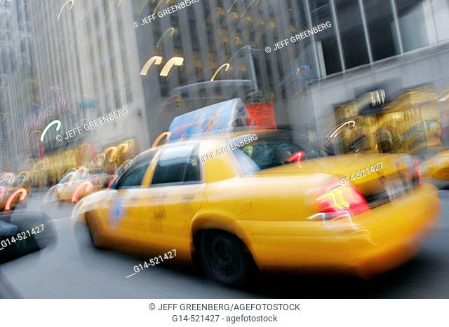 Yellow taxi cabs, blur, motion, movement, speed. Avenue of the Americas. Midtown Manhattan. New York. USA